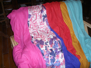 A collection of beautiful pashminas and some printed silk shawls